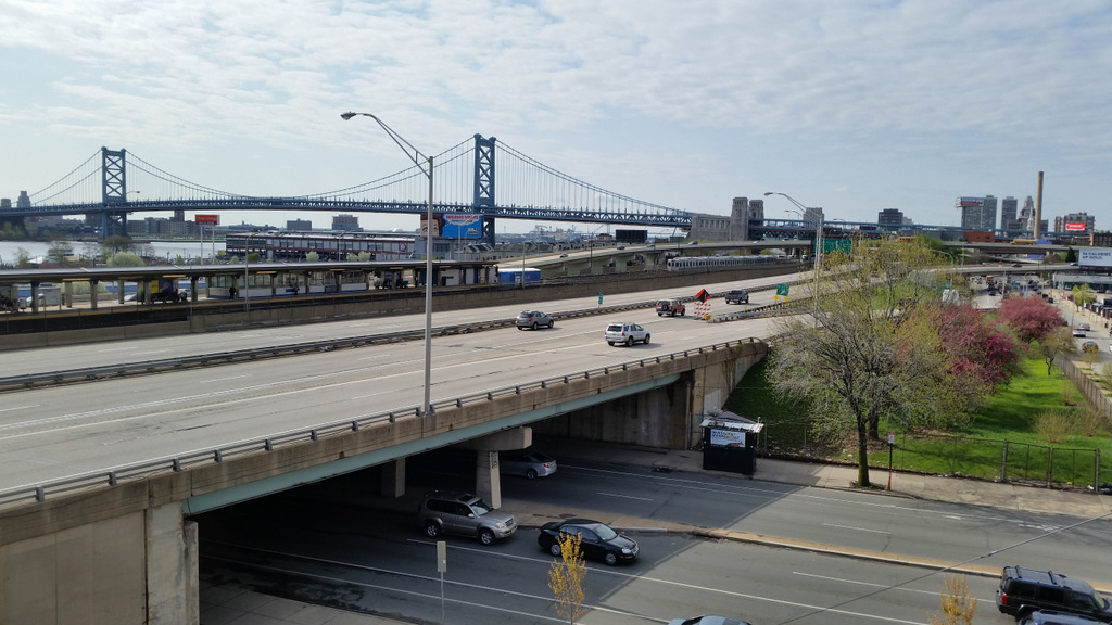 Springtime view of Ben Franklin Bridge from Liberties Gateway